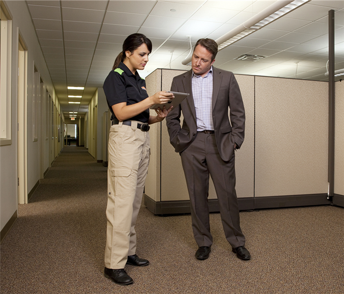 SERVPRO employee with man in a suit in an office setting