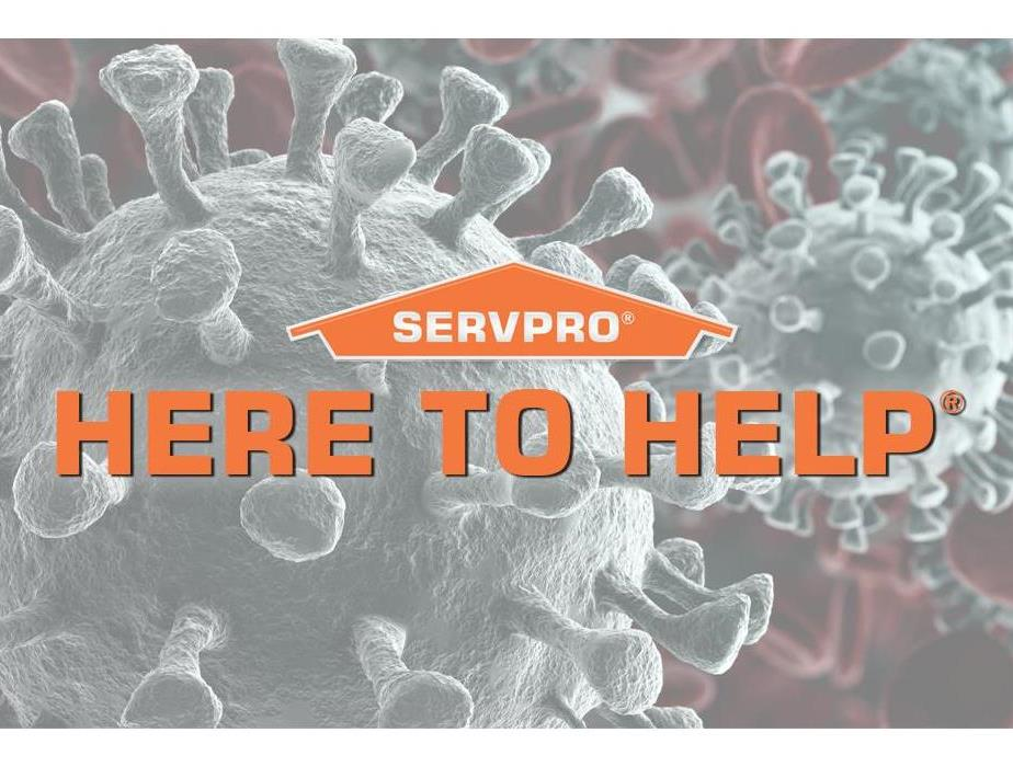 COVID-19 virus strain in the background with orange SERVPRO logo and tag line HERE TO HELP written in orange in center