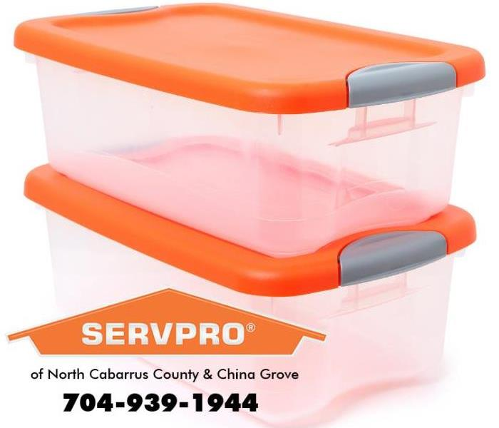 Two plastic bins with orange lids are shown.